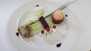Poached pear in red wine with blue cheese salad
